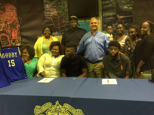 Godby's Jaylin Stewart (left) signed with Division-I SE Missouri State recently, while teammate Quan Patterson signed with Spring Hill College in Alabama.