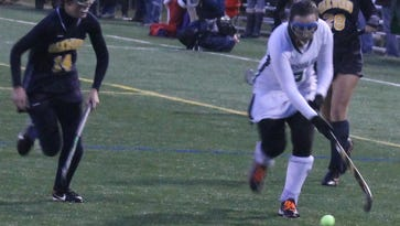 Ursuline junior Jillian Shive makes a run up the field against Oakwood. She scored twice in the victory.
