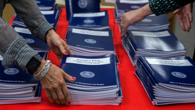 Copies of President Trump's budget are pictured at the Government Printing Office on March 16, 2017.