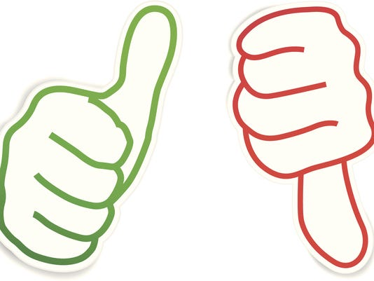 Thumbs up and down on paper