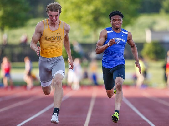 HSE's Noah Malone, right, and Carmel's Ryan Lipe compete for first place in the 100-meter dash during the boys sectional track and field finals at Carmel High School on Thursday, May 18, 2017. Lipe would win the event.
