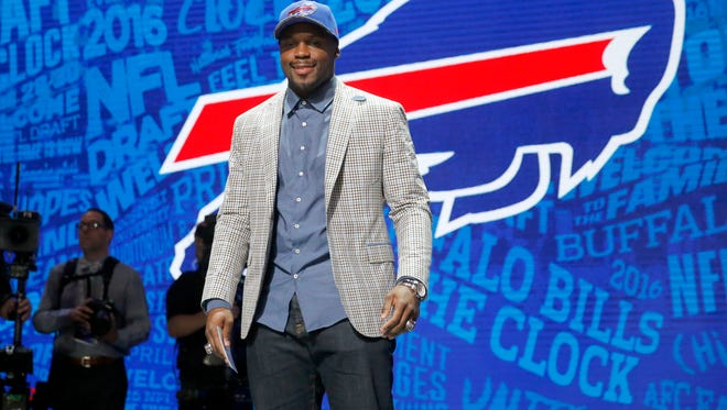 Alabama's Reggie Ragland poses for photos after being selected by the Buffalo Bills as the 41st pick in the second round of the 2016 NFL football draft, Friday, April 29, 2016, in Chicago. (AP Photo/Charles Rex Arbogast)
