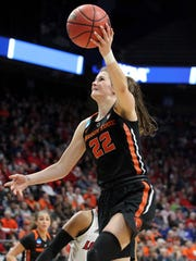 Oregon State's Kat Tudor (22) shoots while defended by Louisville's Asia Durr during the first half of an NCAA women's college basketball tournament regional final, Sunday, March 25, 2018, in Lexington, Ky.