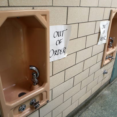 Out of order notices were taped near the drinking fountains