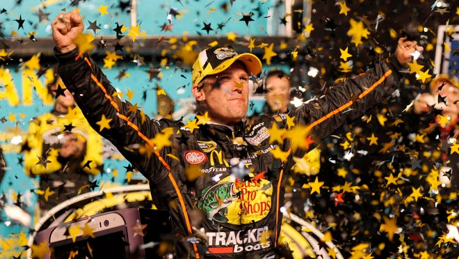 Jamie McMurray celebrates in victory lane after winning the Sprint All-Star Race at Charlotte Motor Speedway.