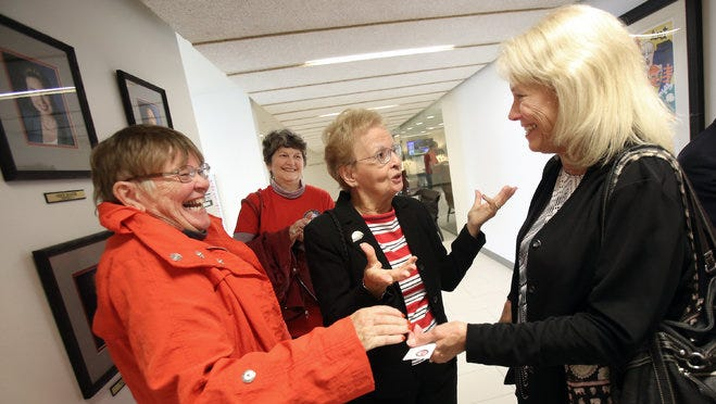 Holly Swogger (right), president of West Tennessee Veterans Home Inc., celebrates with supporters (from left) Candi Schoenberger, Sally Harrison and Janice Vanderhaar after a General Government committee meeting of the Shelby County Board of Commissioners in this October 2015 file photo. In a resolution sponsored by Chairman Terry Roland the charitable organization was awarded a total of $145,000 in county funds from the FY 2016 operating budget.