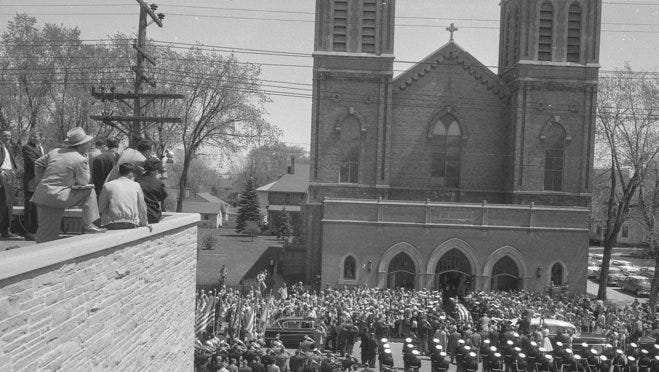 A crowd jams the sidewalks and street outside St. Mary's Catholic Church in Appleton on May 7, 1957, where funeral services were being held for U.S. Sen. Joseph R. McCarthy. This photo was published in the May 8, 1957, Milwaukee Journal.
