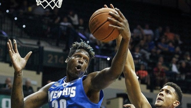 February 20, 2016: University of Memphis forward Nick Marshall (left) grabs a rebound in front of University of South Florida defender Angel Nunez (right) during first half action at the Sun Dome in Tampa, Florida.