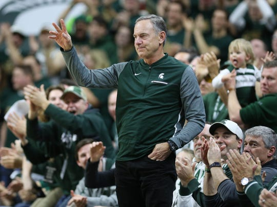 Michigan State fans give football coach Mark Dantonio a standing ovation in the second half against Maryland on Thursday, Jan. 4, 2018 at the Breslin Center in East Lansing.