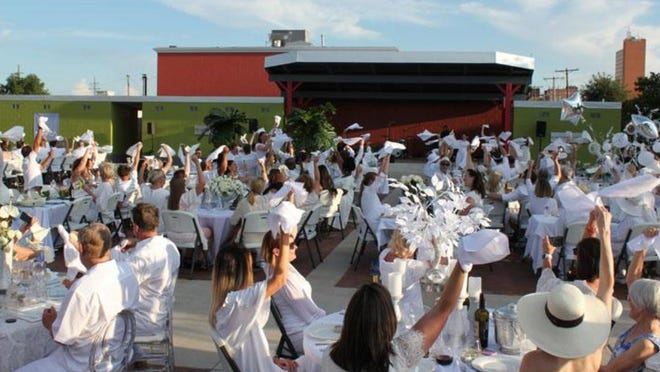 Lubbockites gather at the 2018 Dîner en Blanc fundraising event at the Louise Hopkins Underwood Center for the Arts in downtown Lubbock. Due to the ongoing pandemic, this year's event will be held virtually on Friday, Aug. 21.