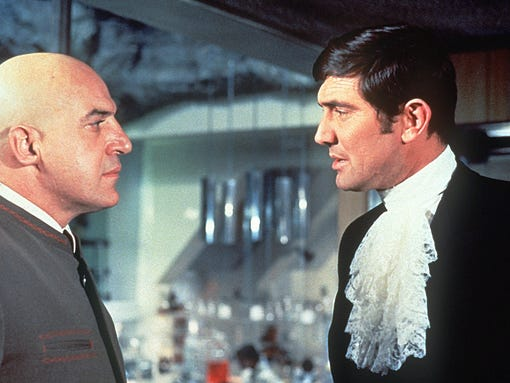 """Telly Savalas, left, with George Lazenby as James Bond in """"On Her Majesty's Secret Service."""""""