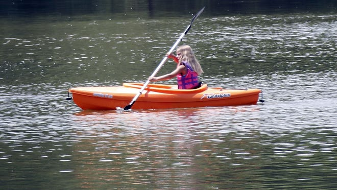 A kayaker heads out for a paddle on Charles Mill Lake on Wednesday.