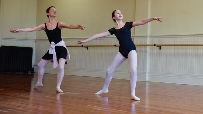Ellen Gunn, (left), owner of the Monmouth Academy of Ballet in Red Bank, teaches a private lesson to Alyssa Cohen, 12, of Holmdel.