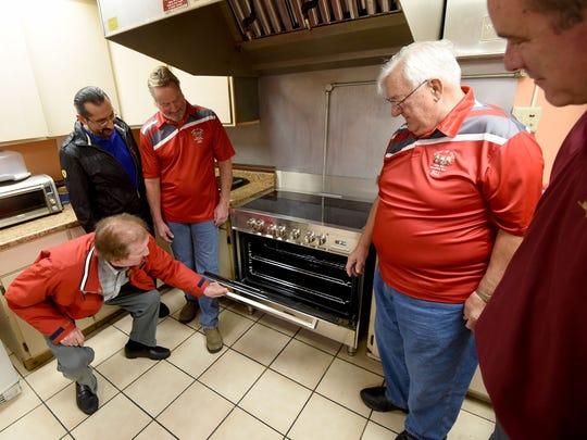 In this photo, taken in November, Doc Stumbo, Dr. Christian Baddour, David Lemming, Bill Marzetti and Carl Neutzling admire the new stove donated to the Harmony House. The new electric stove was donated to Harmony House by Dr. Christian Baddour, and the Owls Club and IBEW members hooked up the new electric commercial stove.