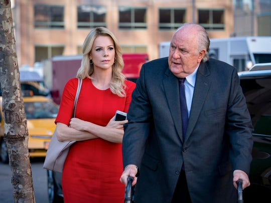 "Charlize Theron, left, as Megyn Kelly and John Lithgow as Roger Ailes in a scene from ""Bombshell."""