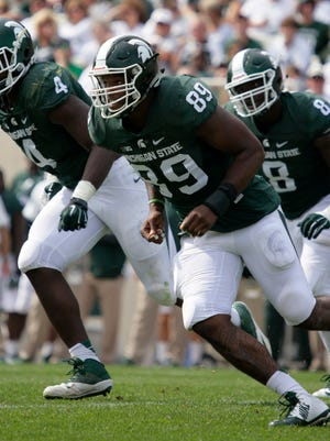 Michigan State's Shilique Calhoun (89), Malik McDowell (4) and Lawrence Thomas pursue the ball against Central Michigan during the second quarter of an NCAA college football game, Saturday, Sept. 26, 2015, in East Lansing.