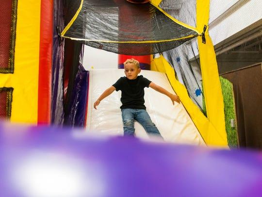 Hunter McCafferty slides down the inflatable slide
