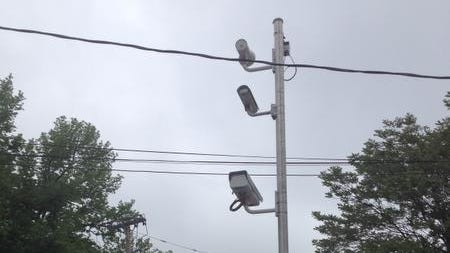 A red-light camera on McLean Avenue in Yonkers watches the intersection with Putnam Avenue.