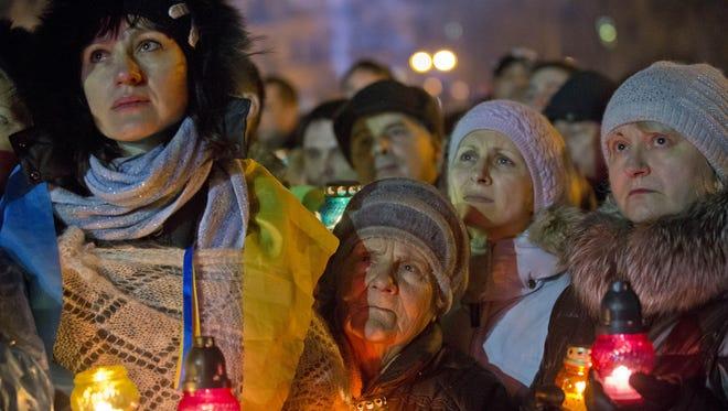 Supporters listen to former Ukrainian Prime Minister Yulia Tymoshenko as she addresses the crowd Saturday in central Kiev, Ukraine. Tymoshenko praised the demonstrators killed in violence as heroes.