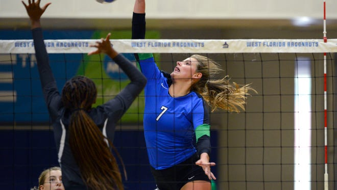 West Florida's Nadine Williams goes for the spike Saturday, September 30, 2017 during play against Auburn Montgomery at the UWF Field House.