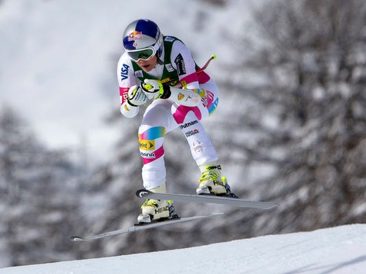 Vonn of the U.S. is airborne as she clears a gate to win the ladies' World Cup Super-G skiing race in Cortina D'Ampezzo