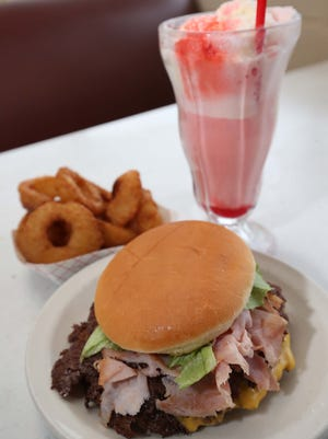 The Double Hamburger with Ham and Onion Rings and a Cream Soda float at Taylor's Drive-in