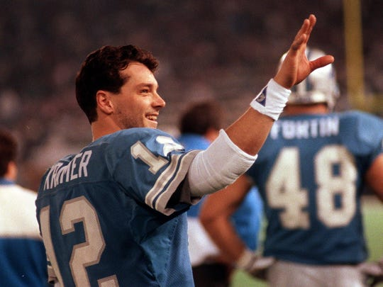 Lions quarterback Eric Kramer waves to the crowd during Detroit's 38-6 playoff win over Dallas on Jan. 5, 1992. Kramer threw for 341 yards and three touchdowns.