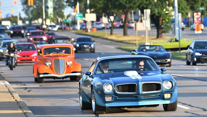 A variety of classic cars roll along Woodward in Royal Oak as Dream Cruise week gets underway Wednesday evening, Aug. 16, 2017.