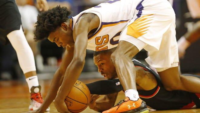 Phoenix Suns forward Josh Jackson (20) grabs a loose ball from Portland Trail Blazers guard Damian Lillard (0) during the first quarter in pre-season NBA action at Talking Stick Resort Arena in Phoenix, Ariz. October 11, 2017.