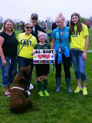 Makenzie O'Toole (with sign) got a visit at one of