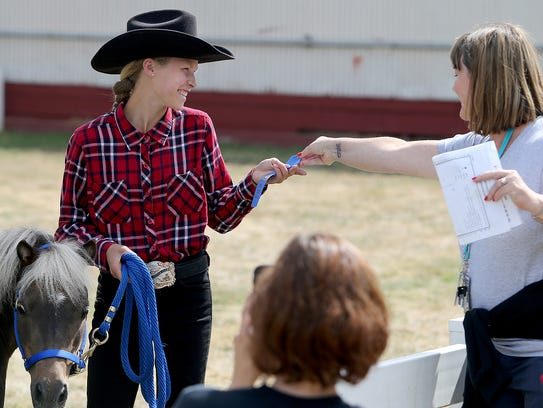 Ambyr Halfhill , 15, of Port Orchard won a blue ribbon