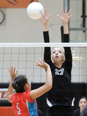 Aztec's Reigan Weaver blocks a shot during a match against Shiprock on Thursday at Lillywhite Gym in Aztec.
