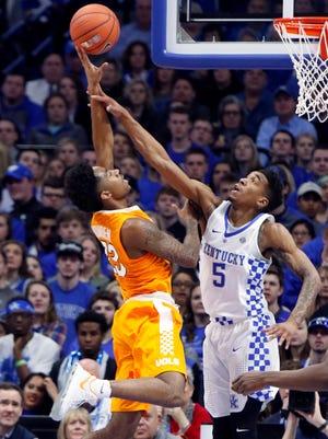 Tennessee's Jordan Bowden, left, shoots over Kentucky's Malik Monk on Tuesday in Lexington, Ky.