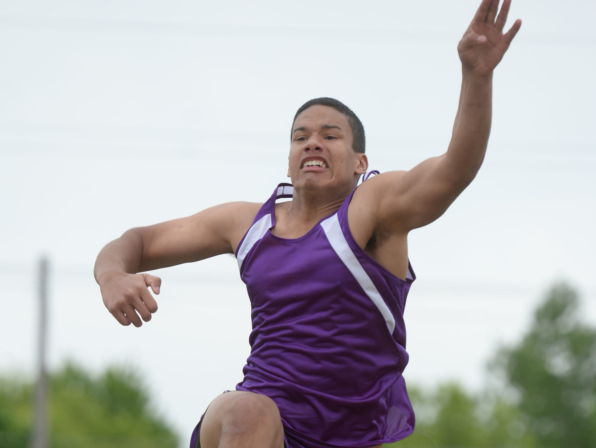 Hagerstown's Martin Block competes in the long jump during the TEC Track and Field meet Thursday, May 14, 2015, at Northeastern in Fountain City.