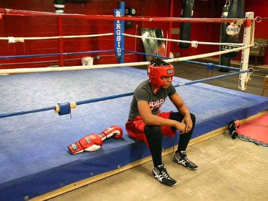 Cierra Taylor  after a sparring session while working out at World Gym on East Ave.  Taylor, a single mother of three, will fight in the USA Olympic Boxing  Trials in Memphis, Tennessee.