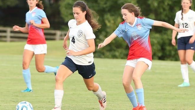 Madison's Meredith Nye (4) and USJ's Sara Mitchell (6) go for the ball on Aug. 22, 2017.