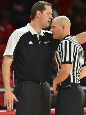Northern Kentucky's John Brannen argues a call with the official.
