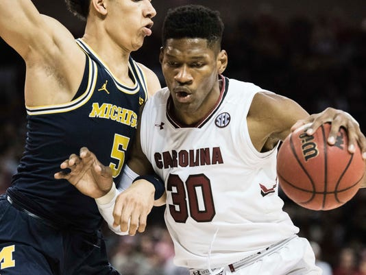 South Carolina forward Chris Silva (30) drives to the hoop against Michigan forward D.J. Wilson (5) during the first half of an NCAA college basketball game Wednesday, Nov. 23, 2016, in Columbia, S.C. (AP Photo/Sean Rayford)