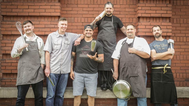 These six men take contemporary Indiana cuisine on the road Aug. 6, when they prepare a five-course meal with cocktails at the venerable James Beard House in New York City. Standing outside Downtown Indy's Zesco Restaurant Supply Store are, left to right, Milktooth chef/owner Jonathan Brooks; Smoking Goose and Goose the Market chef/owner Chris Eley; Thunderbird co-owner, operator and barman Joshua Gonzales; Cerulean pastry chef Peter Schmutte; Restaurant Tallent in Bloomington chef/owner David Tallent; and executive chef Aaron Butts of Joseph Decuis in Roanoke.