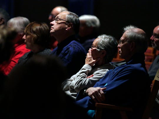 Chintana Haas, second from right, and others listen Sunday to speakers during the Fox Cities Vigil to End Gun Violence, held at the Fox Valley Unitarian Universalist Fellowship in Appleton.