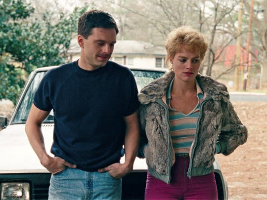 """This image released by Neon shows Sebastian Stan as Jeff Gillooly, left, and Margot Robbie as Tonya Harding in a scene from """"I, Tonya."""" (Neon via AP)"""