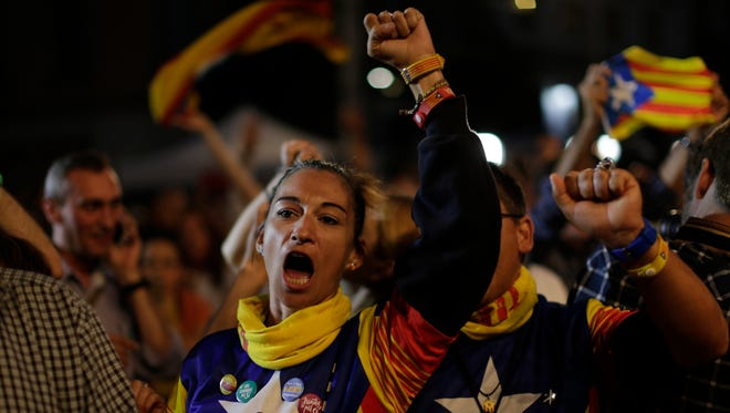 Catalonian independence supporters react in Barcelona, Spain, Sept. 27, 2015.