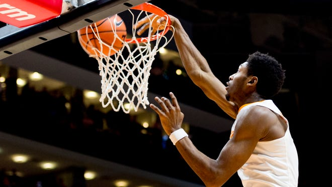 Tennessee forward Kyle Alexander (11) dunks during a game between Tennessee and Texas A&M at Thompson-Boling Arena in Knoxville, Tennessee on Saturday, January 13, 2018.