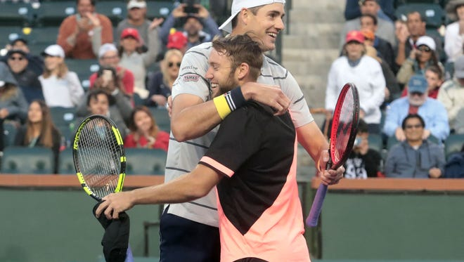 John Isner and Jack Sock, front, celebrate winning the BNP Paribas Open men's doubles final after beating Mike and Bob Bryan in an all American final on Saturday, March 17, 2018 in Indian Wells.