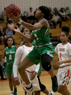 Destanni Henderson of Fort Myers takes a shot against Dunbar in the girls basketball district championship on Friday, Feb. 9, 2018, in Fort Myers.