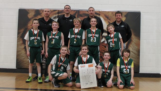 The D.C. Everest fourth-grade boys basketball team finished in first place at a tournament in Stratford on Jan. 10, going 4-0. Front row, from left: Conner McFarlane, Jack Weisenberger, Matthew Nielsen, Will Gutierrez. Middle row: Cayden Aures, Matthew Ruether, Preston Miller, Marcus Hall, Brandon Durante. Coaches: Marlen Weisenberger, Jason McFarlane, Tom Ruether, and Derek Durante.