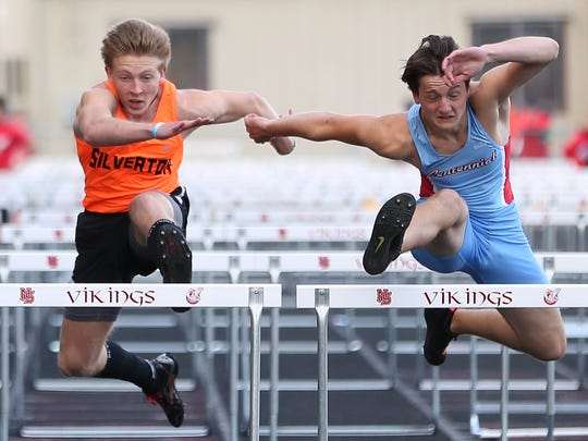 Silverton's Brock Rogers and Centennial's Yelisey Gurzhuy compete in the 110 meter hurdles on Friday, April 15, 2016, during the Vikings Relays Twilight Invitational track and field meet at North Salem High School.
