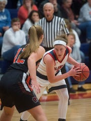 New Oxford's Presley Berryhill looks to get past Central York's Katie Fabbri during play at New Oxford on Tuesday, Jan. 3, 2017. Central York defeated New Oxford, 61-32.