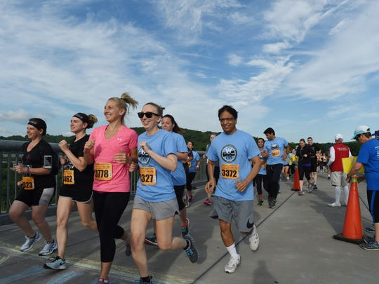 Runners in the Treetops to Rooftops 5K run along the