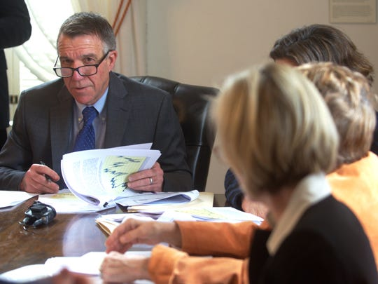 Gov. Phil Scott reviews Vermont's economic forecast at a meeting of the Emergency Board in Montpelier on Jan. 19, 2017.